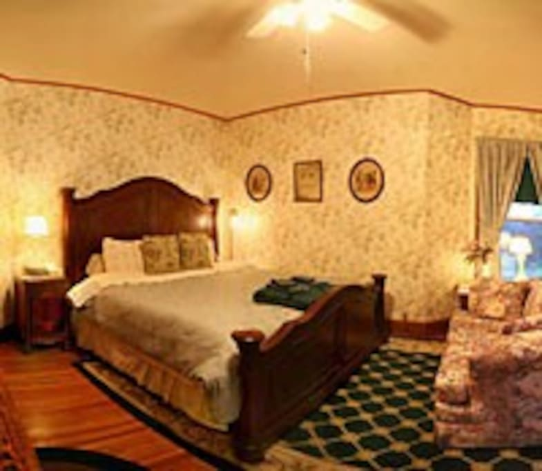 Emerald room has a king bed located in the turret with private bathroom