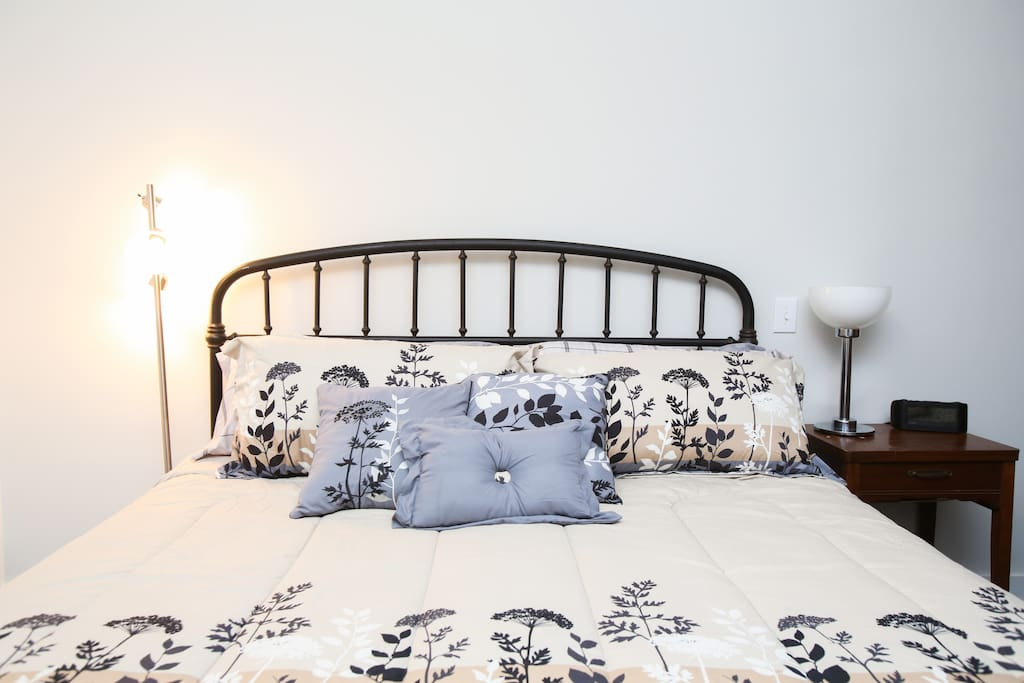 Romantic king bed with fluffy pillows