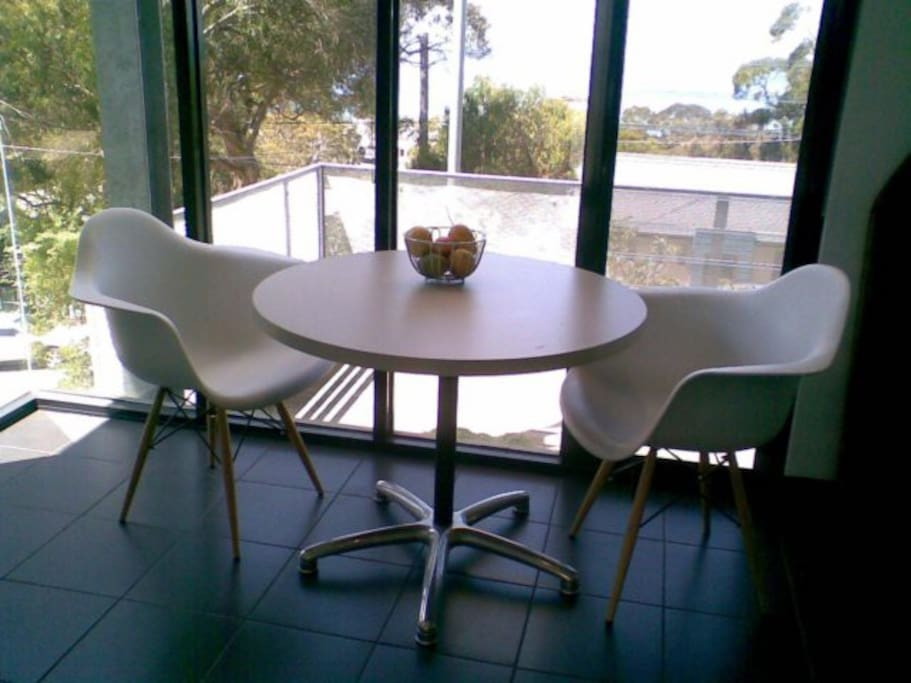 Dining/Kitchen overlooking ocean-facing deck on a dull day!