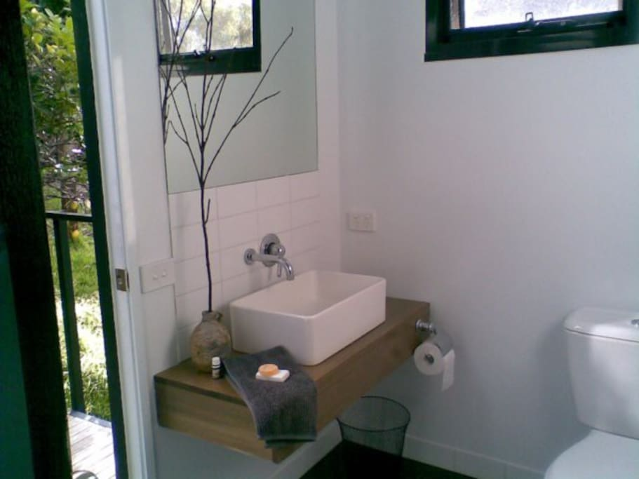 Luxe Bathroom incorporating separate shower, WC and laundry facilities.