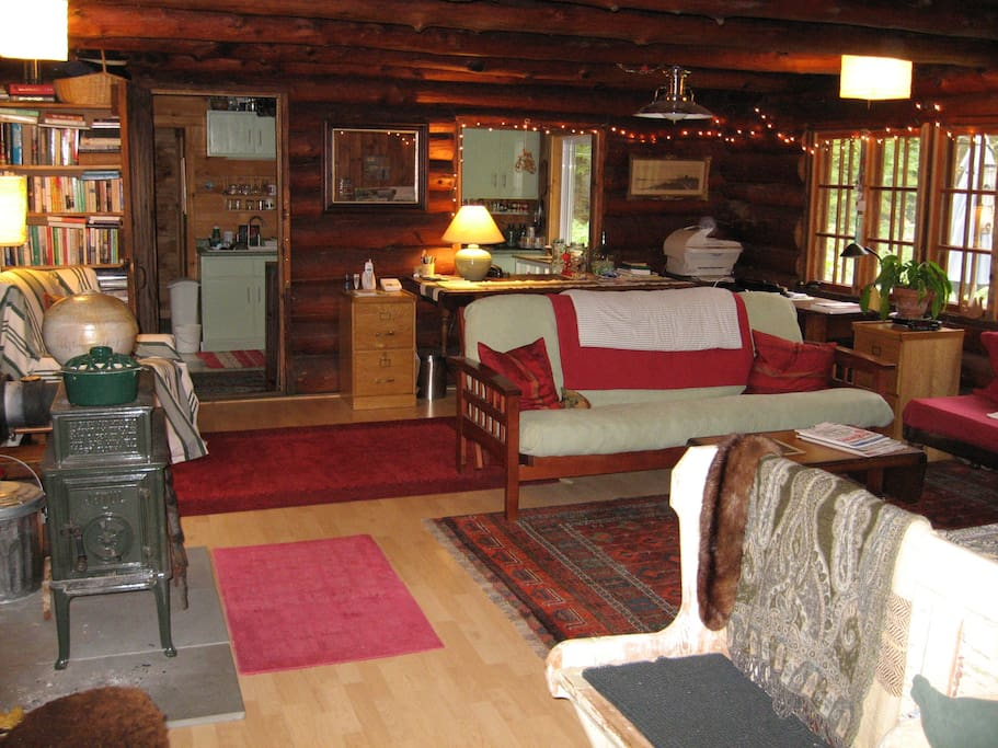 Living room with wood stove - firewood included with rental