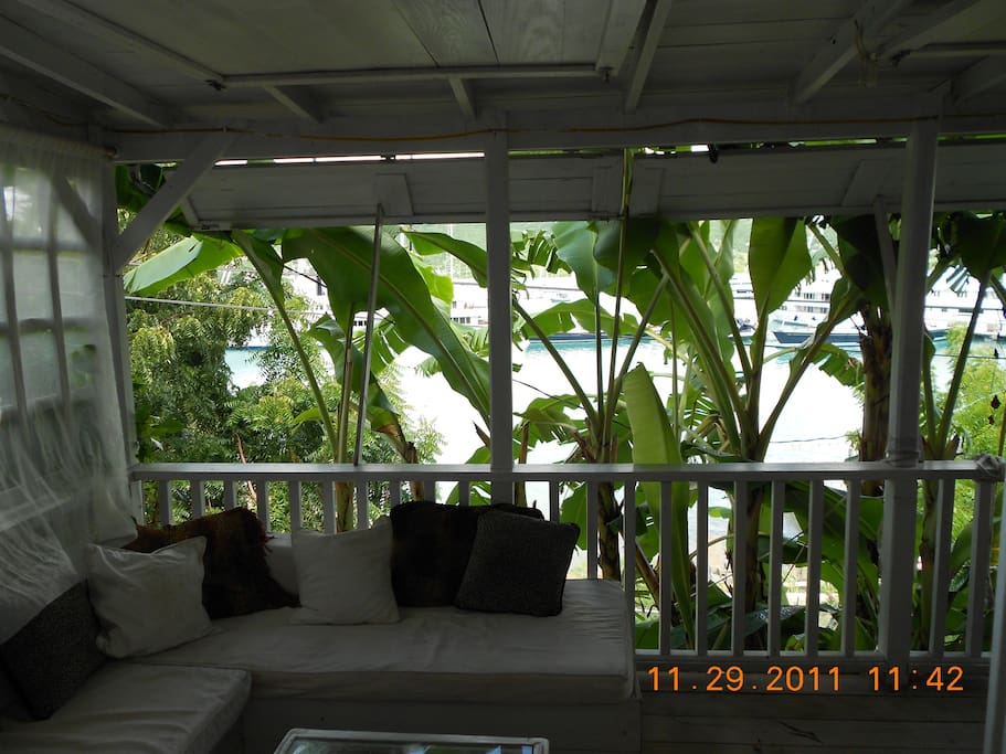 A jungle view through the banana trees of the harbour right below the balcony.
