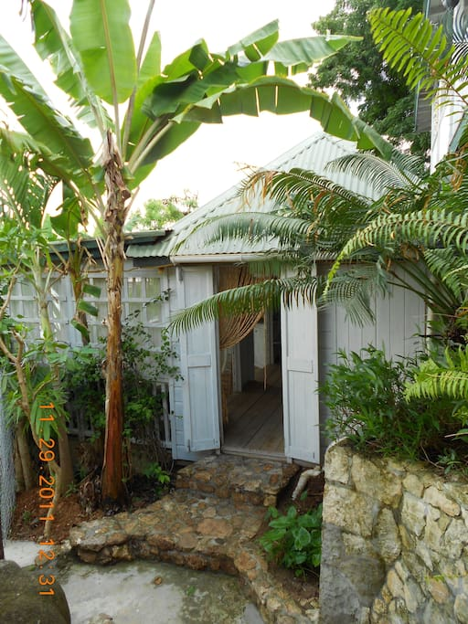 The front door of Rum Jungle....The name is well known!  Next to the main gate and entrance to the Pineapple House property, this little cottage has a history of being a party house....Check it out!