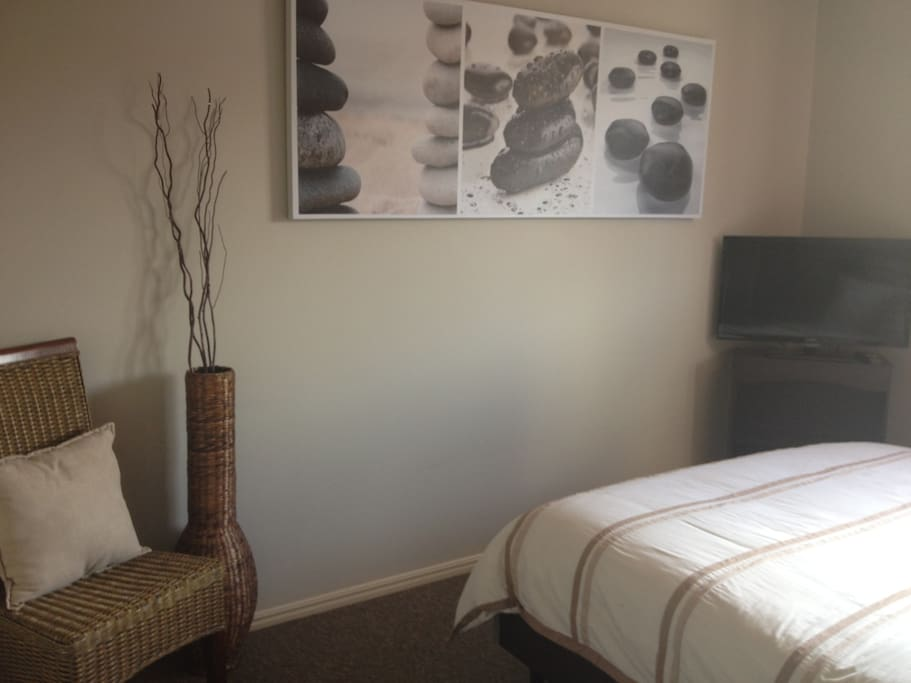 Queen Size Bedroom with flat screen TV, ceiling fans, very spacious.