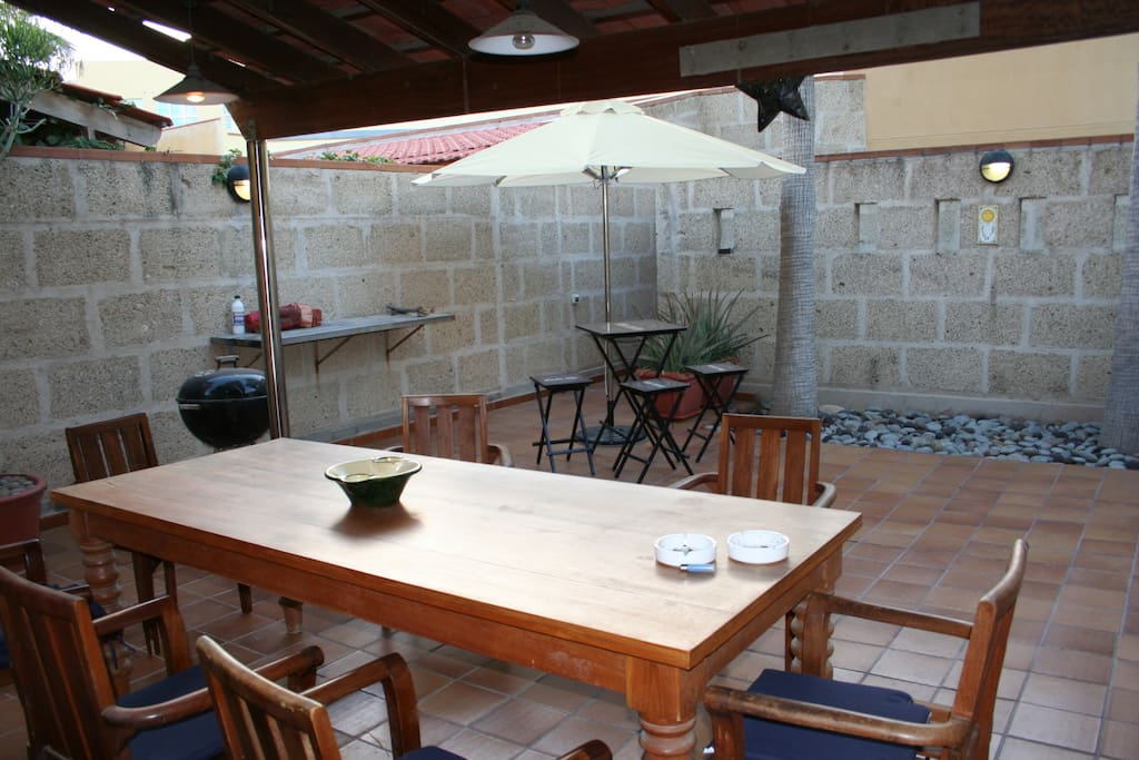 The back terrace, sheltered from the wind ... with bbq, shade ... and a hot shower in the corner!