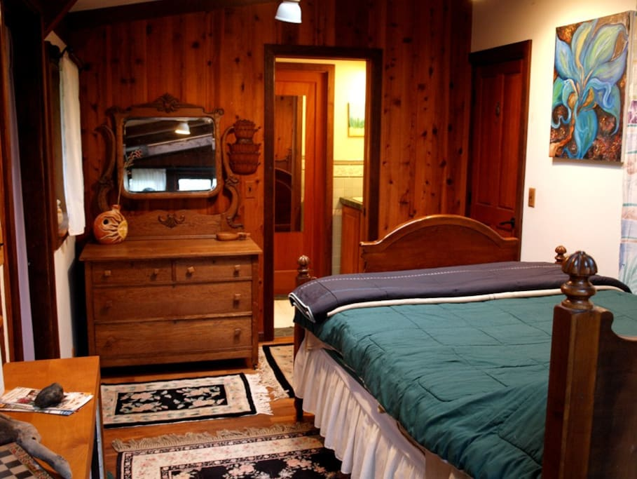 The larger guest bedroom with a view into the bathroom that separates the two guest rooms.
