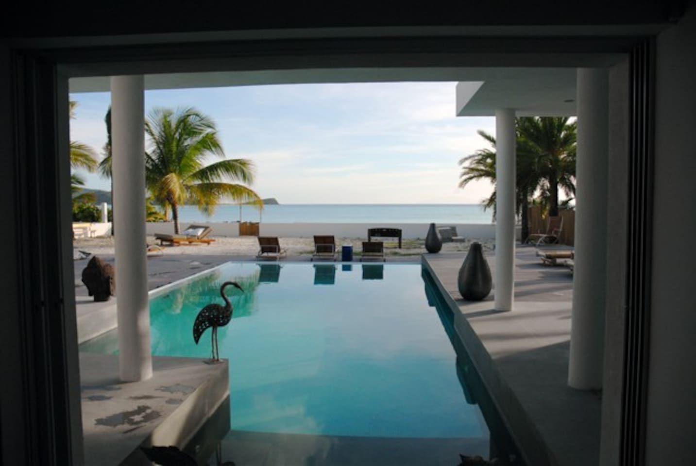 View from the living room out to your own private infinity pool and beach