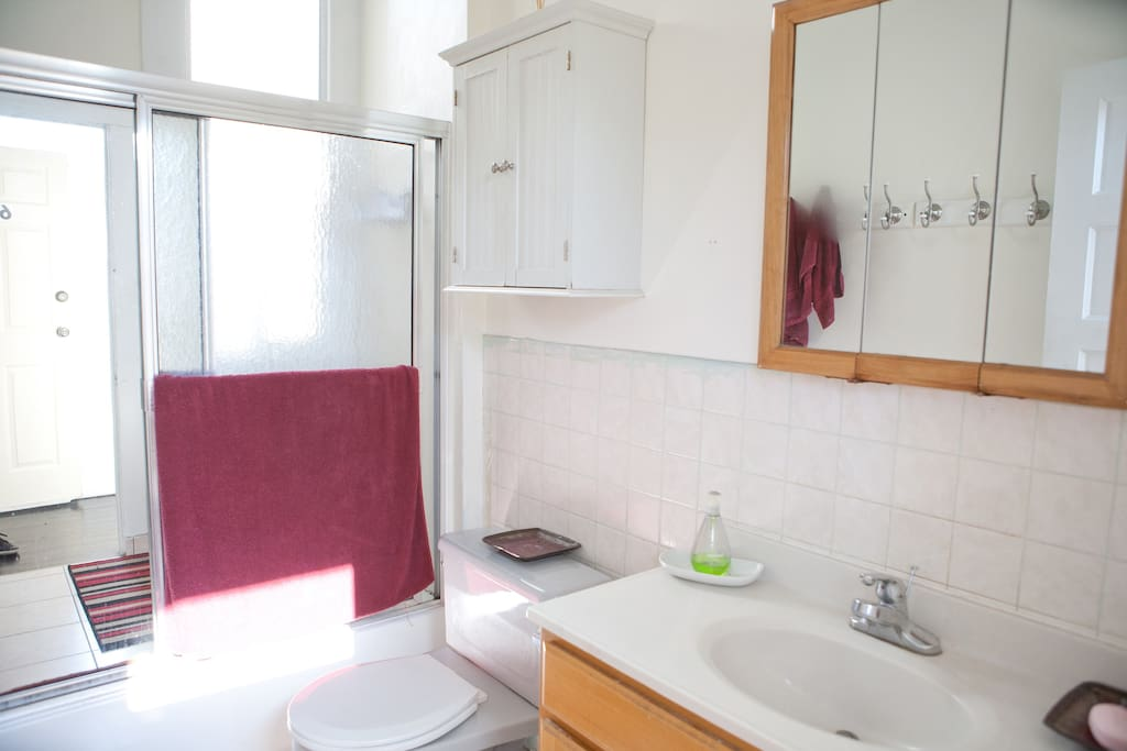 Clean bathroom with fresh towels and laundry in the space.