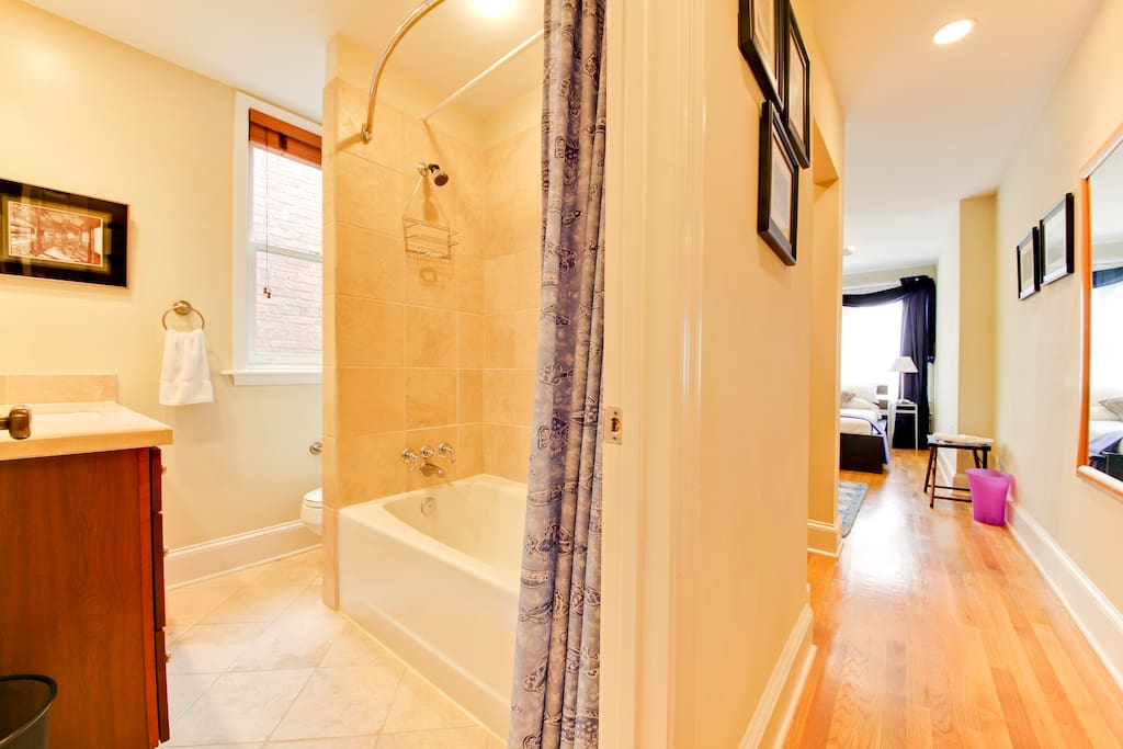 Full bath with huge 4 ft vanity and wax dipped limestone tiles!