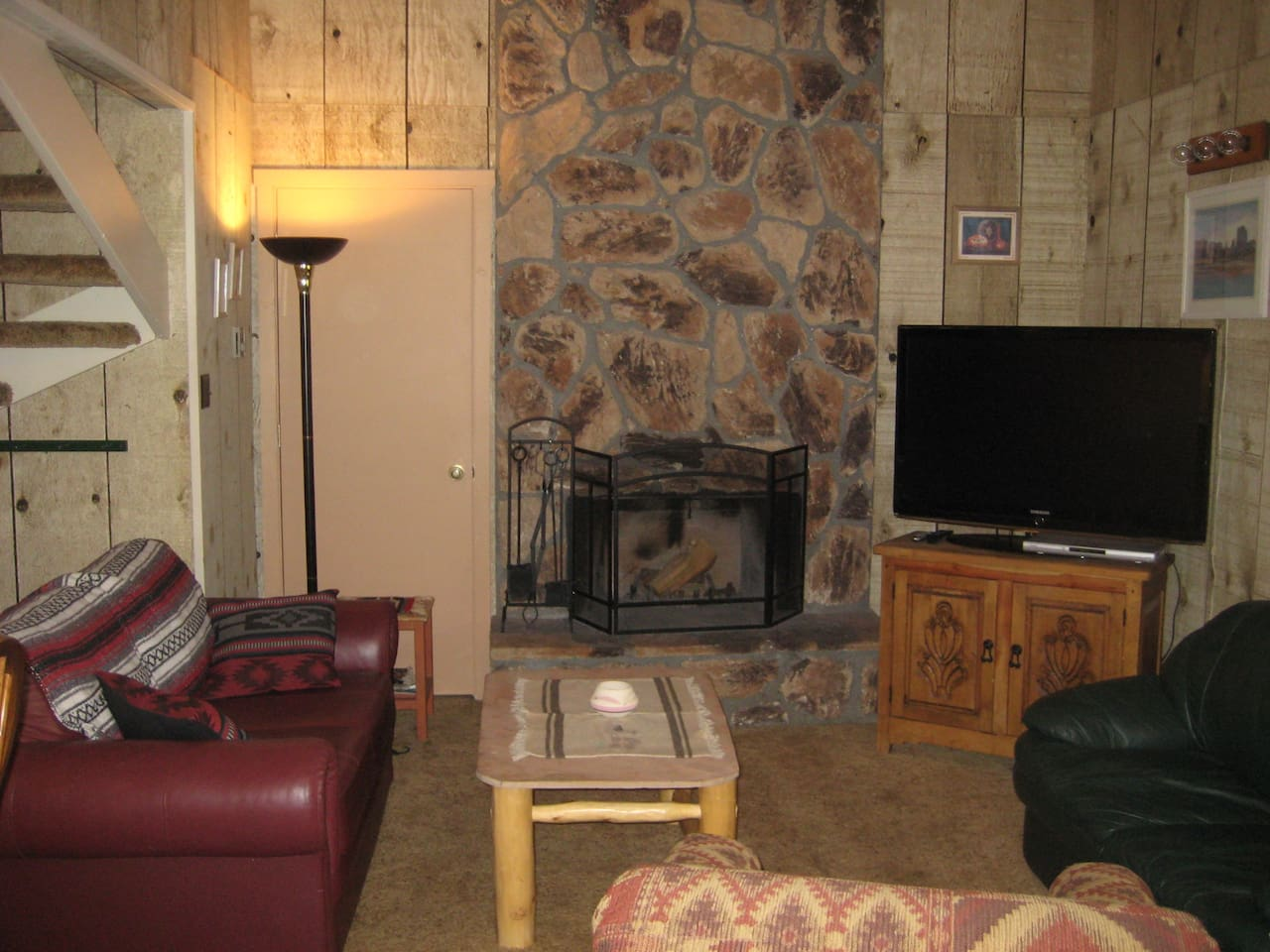 "Living Area with wood burning fireplace and 48"" flat screen TV."