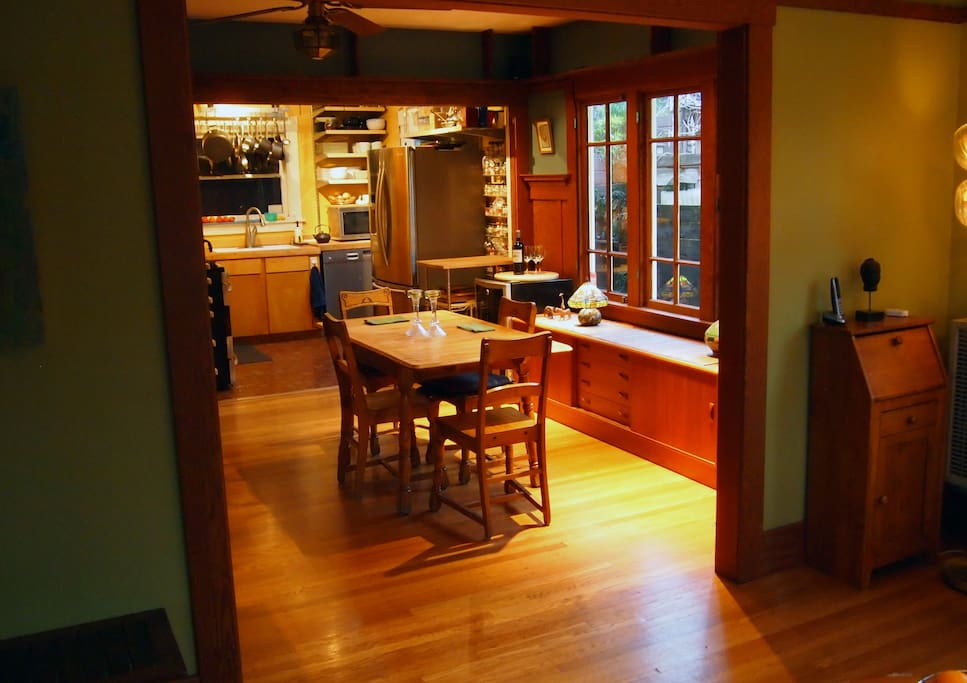 The view of the dining room from the living room, adjacent to an open kitchen.