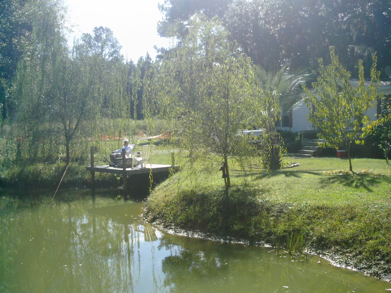 Enjoy an early morning cup of coffee on the deck overlooking the fish pond