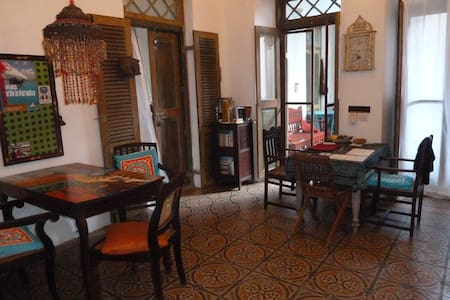 Our apartment is in the old centre of lively Stonetown; the house  is Indian style, spacious with two balconies;  fits a family of 2 -4 persons, situated near sea, shops, musea & restaurants. Staying here will be a real cultural experience, karibuni