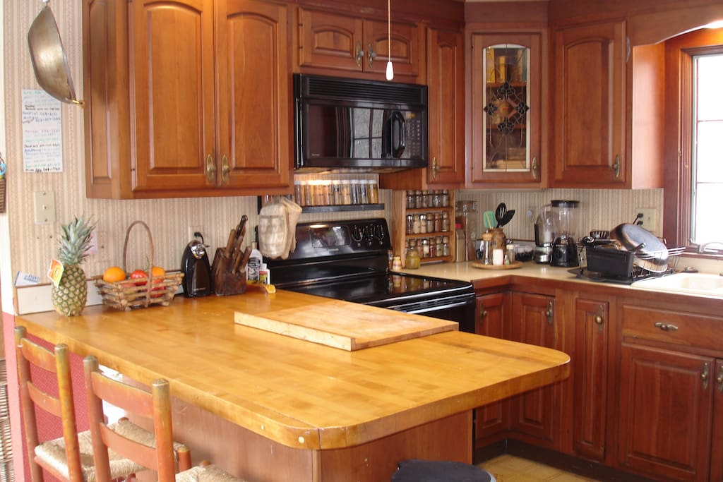 Kitchen with plenty of counter-space, a refrigerator and microwave for your use.