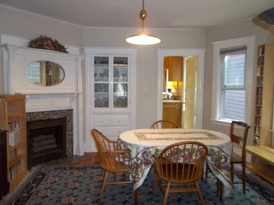 Formal Dining Room (View #2) with Antique Fireplace & Built-In China Cabinet