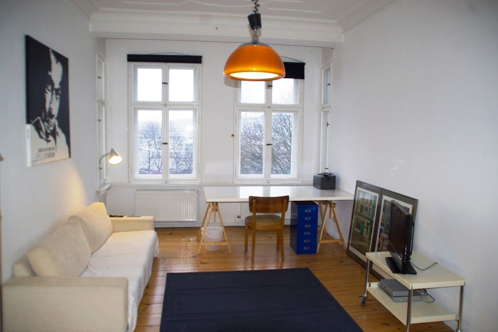 Desksize is 200x100cm. Sofa on the left is suitable to sleep on in case you are 3 guests.