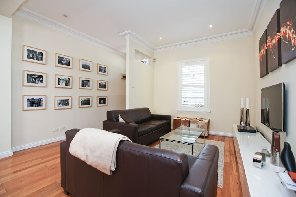 Living room with large flat screen tv and cable