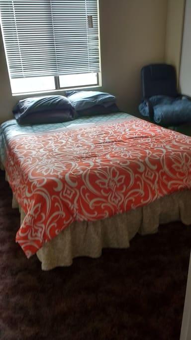Queen bed in the guest bedroom