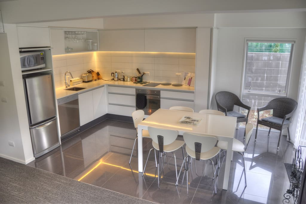 Very modern, open plan kitchen/dining/living area