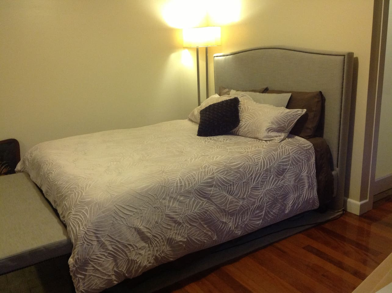 Queen bed with full support mattress and pillow choices, bathroom adjacent. One large room accommodates the sleeping, lounging, and light food preparation activities.