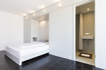 Serviced- Apartment im ehemaligen Design Hotel Q65 - Haus