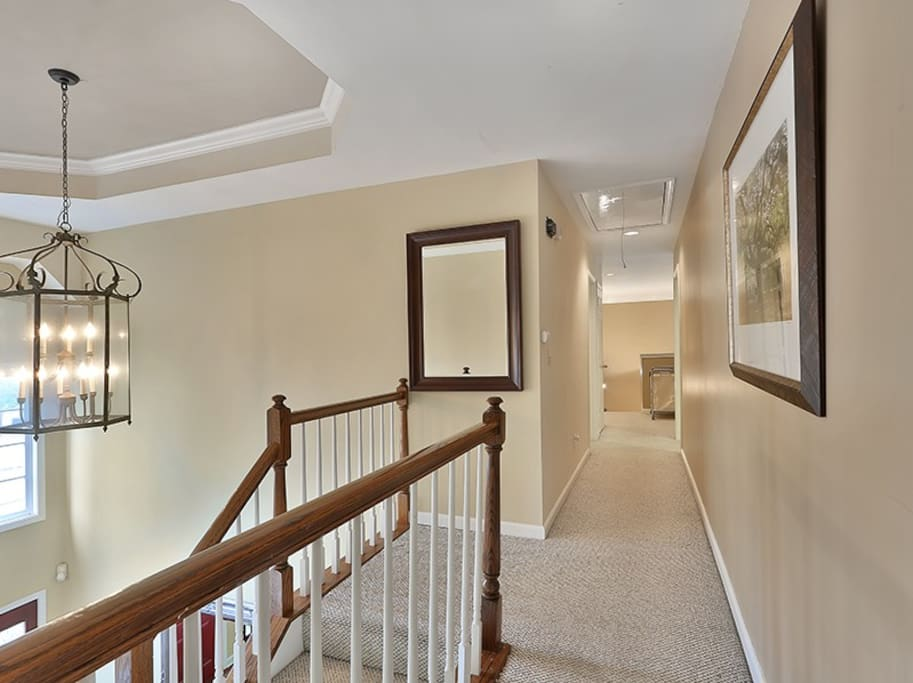 2 floor hall leading to 3 bedrooms and office