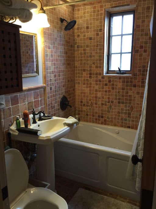 Jetted bathtub and nicely appointed bathroom.