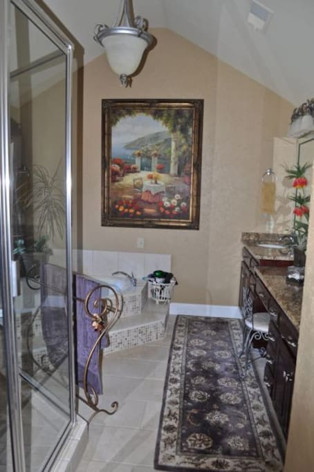 In-suite master bath with double sinks, walk-in shower and garden tub.