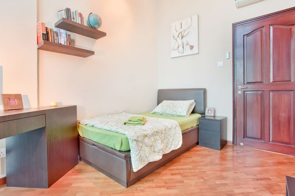 Comfortable super-single bed with a work desk