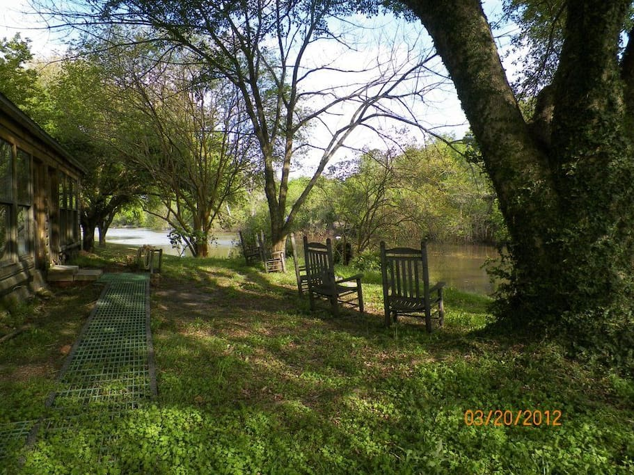 Being in the middle of downtown Breaux Bridge, the Log Cabin's Bayou view is a natural delight.