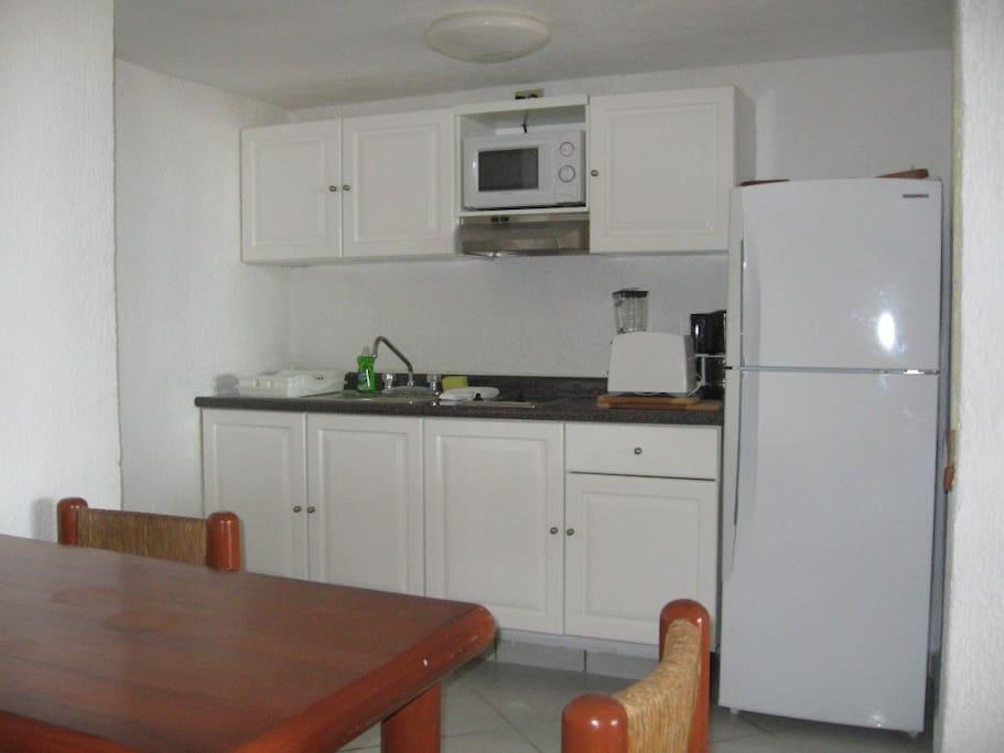 Fully Equipped Kitchenette. Microwave, Toaster, Blender, Coffee Maker, 2 Burner Grill, Fridge