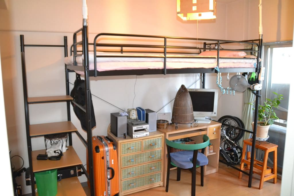 Loft type bed room with desk and CD and radio.