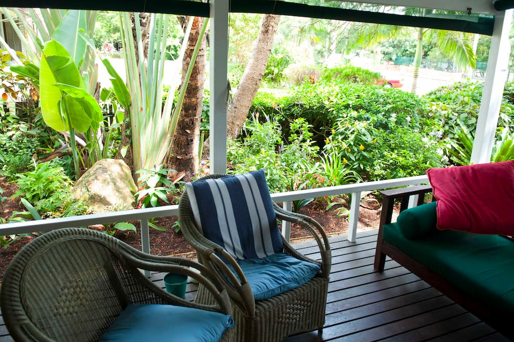 The verandah: new plantings and lots of lazy chairs. Screens roll down for privacy.