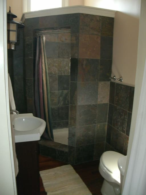 Slate tiled bathroom and shower