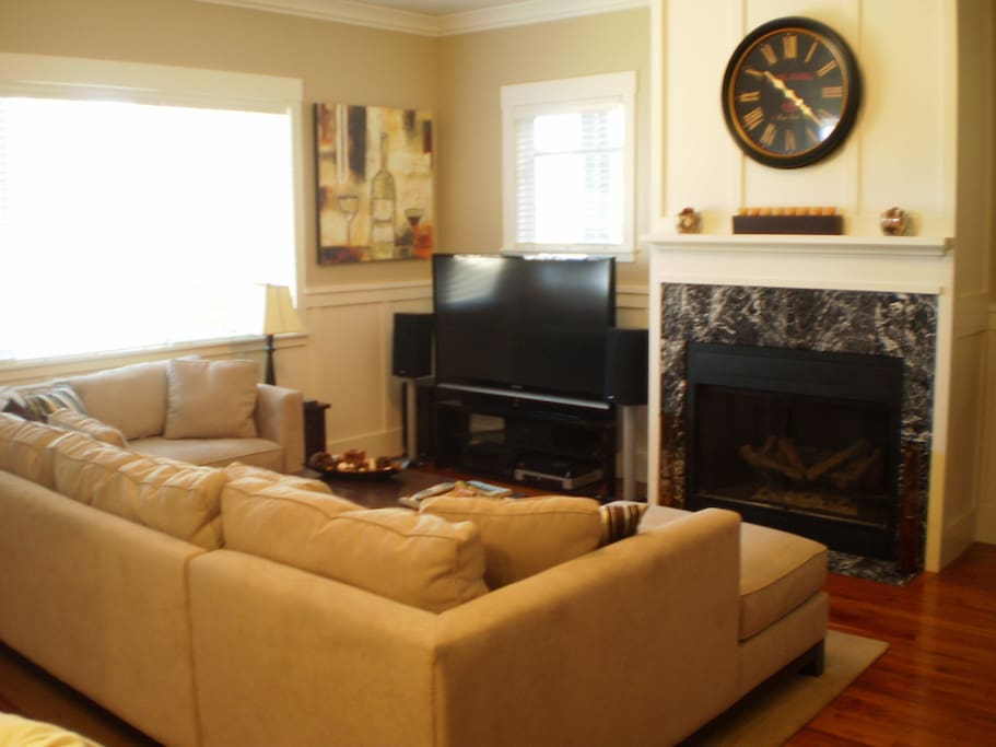 Large Living Room with gas fireplace, 60 in HDTV, and huge sectional