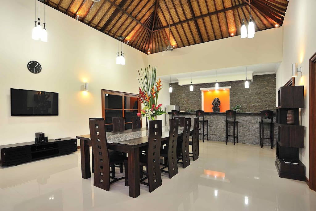 Living Room with 10 Seat Dining Table and Flat Screen TV