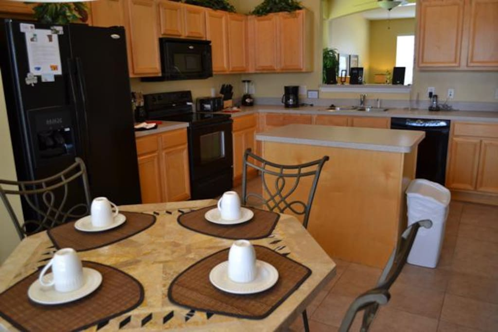 Breakfast table and kitchen