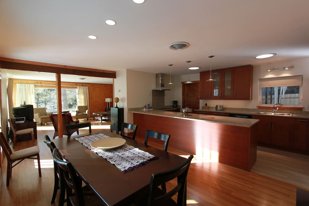 The house provides a comfortable open space with a big kitchen and dining room area. The dining area is connected to the living room.