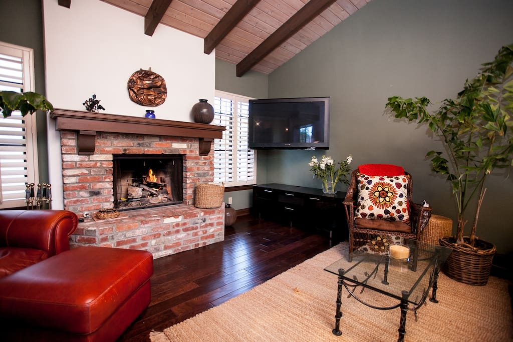 Living room with large screen TV and cozy fireplace