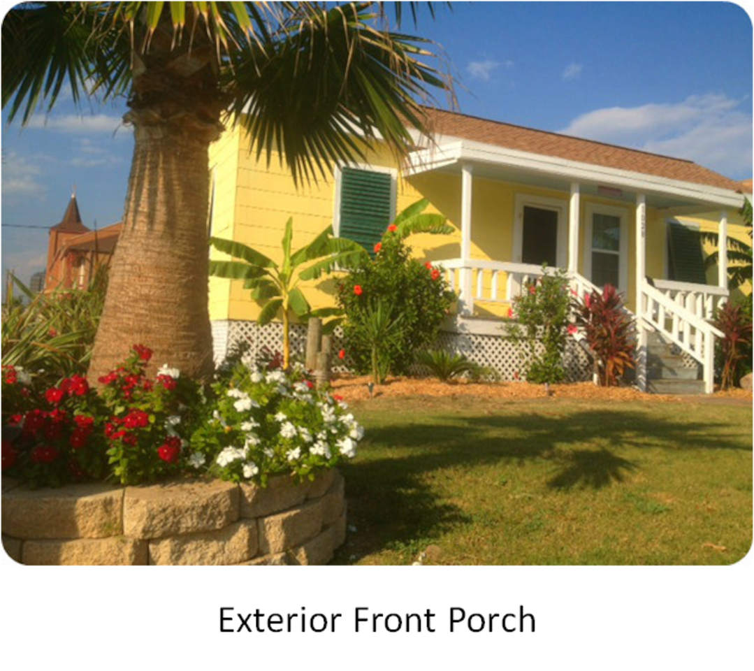 Tropical Key West Bungalow w/spacious covered front porch facing beach that is one block away