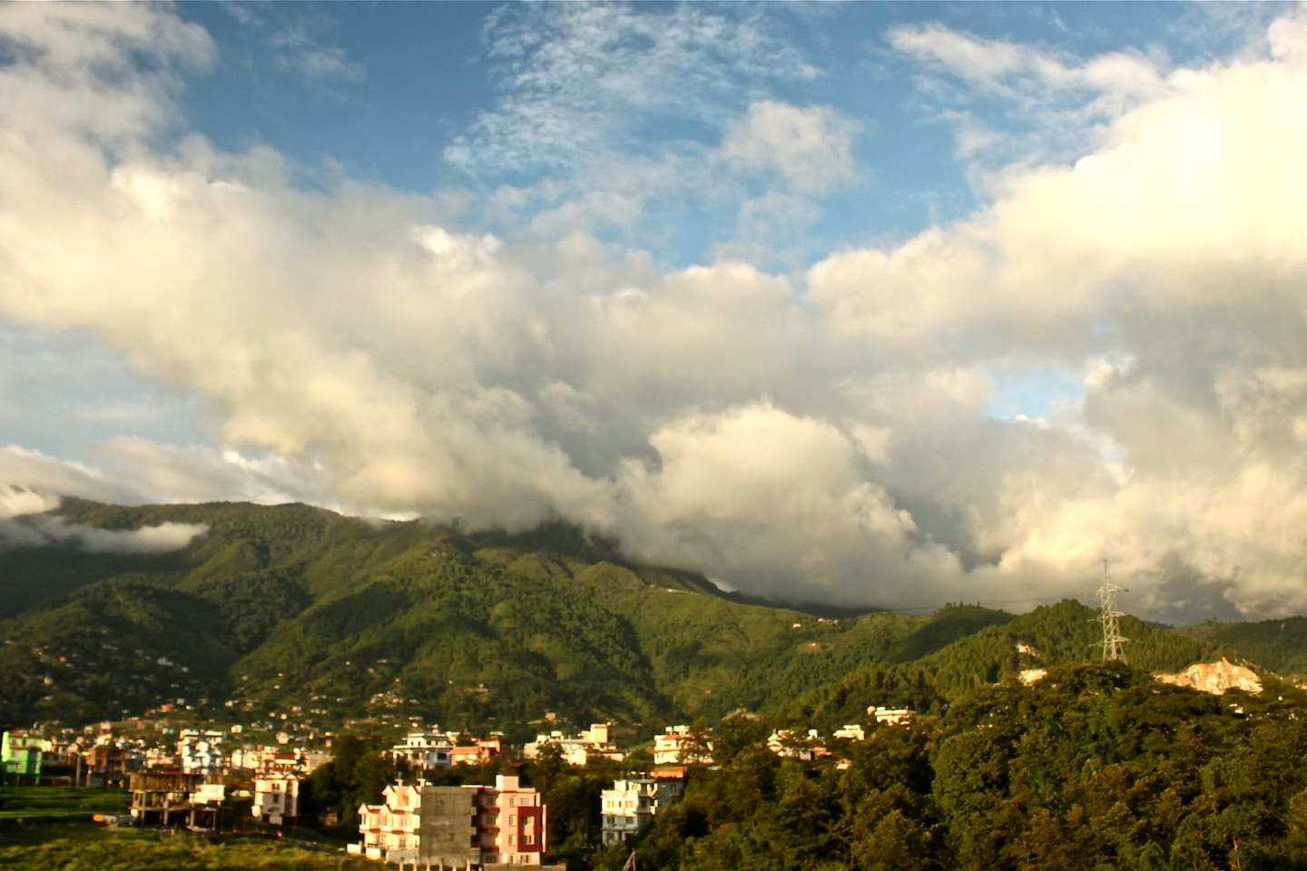 A view of the Shivapuri Hills from the roof top enveloped by the amazing clouds. Taken May last year