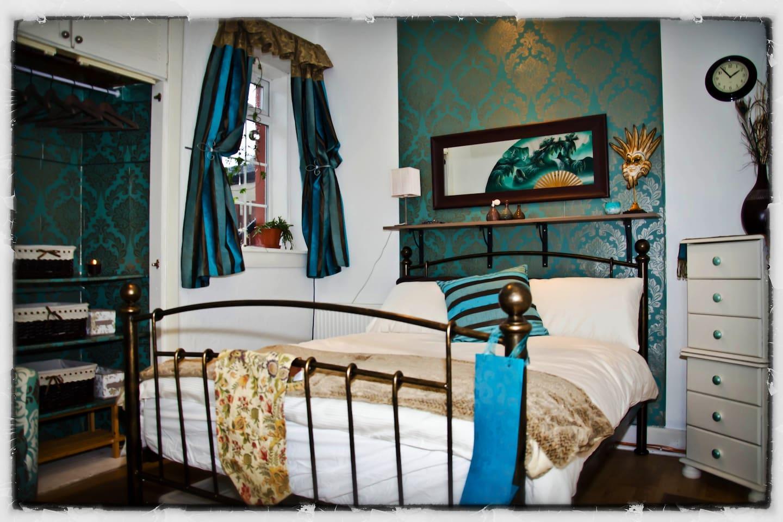 The bedroom, linen provided.