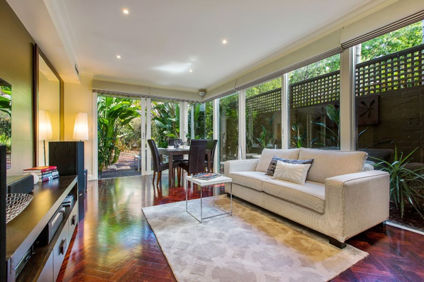 large open plan living & dining area opening onto leafy rear courtyard