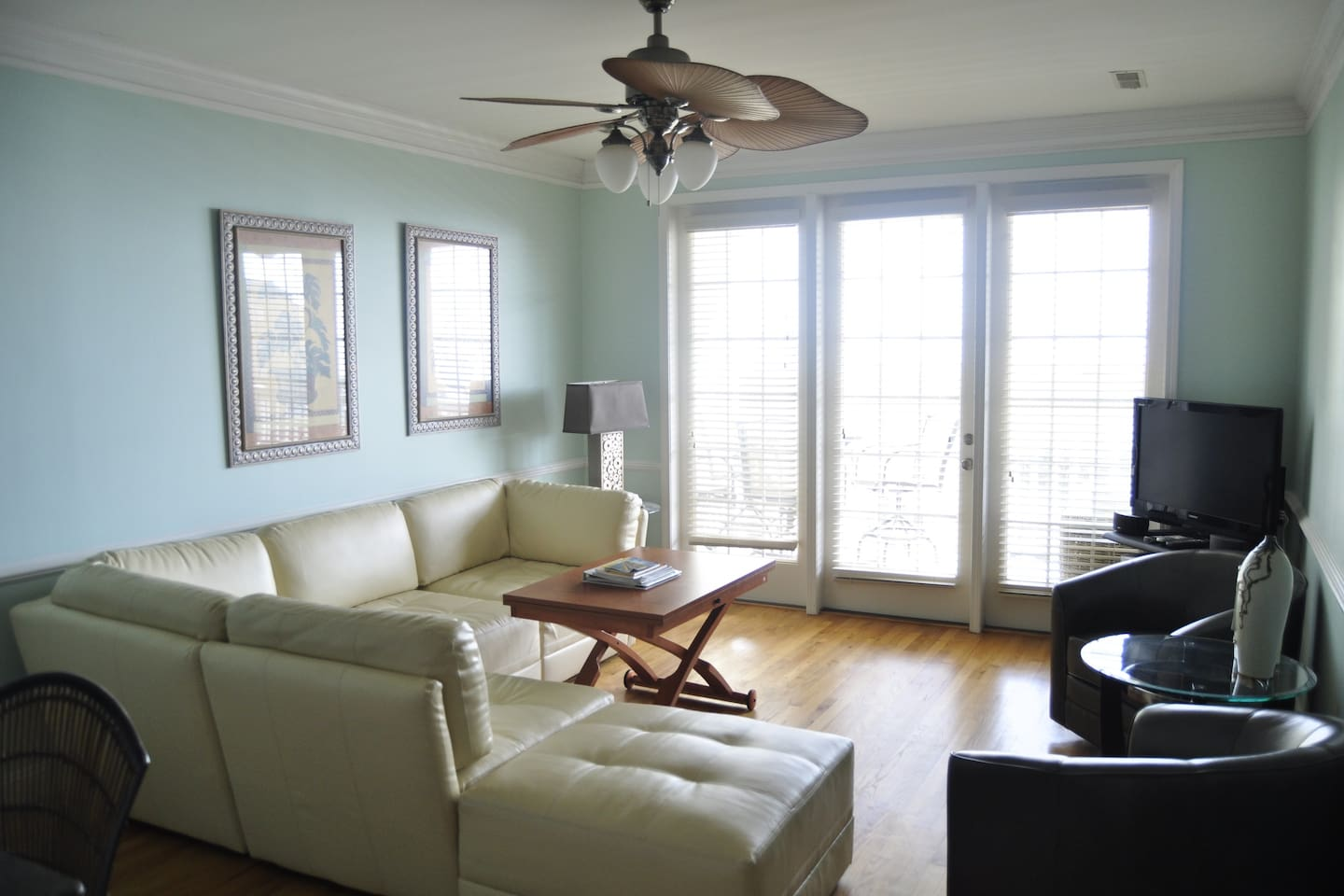 Living room.  Opens to the porch.  Ocean view.  All new furniture