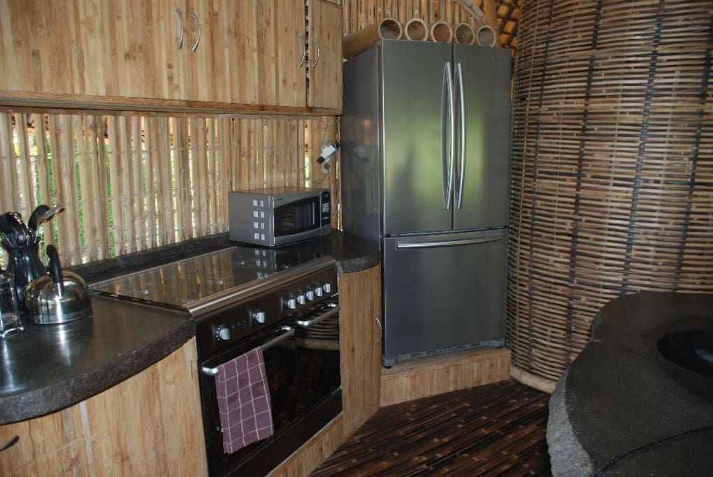 Kitchen close up. Oven and microwave visible