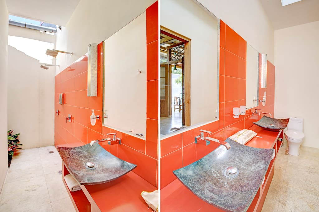 The 1st bedroom has 2 shower heads and 2 hand basins for that little added luxury.