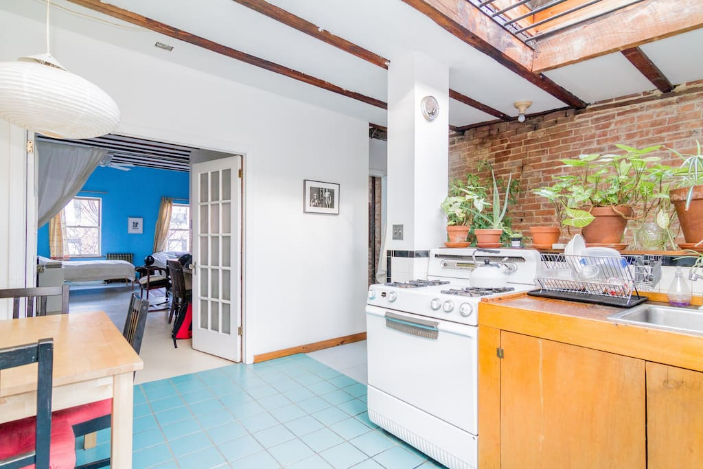 The room is right off the kitchen--both are spacious and bright.
