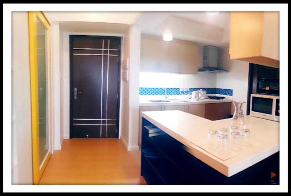 Fully equipped kitchen with plates and table setting for 8 people