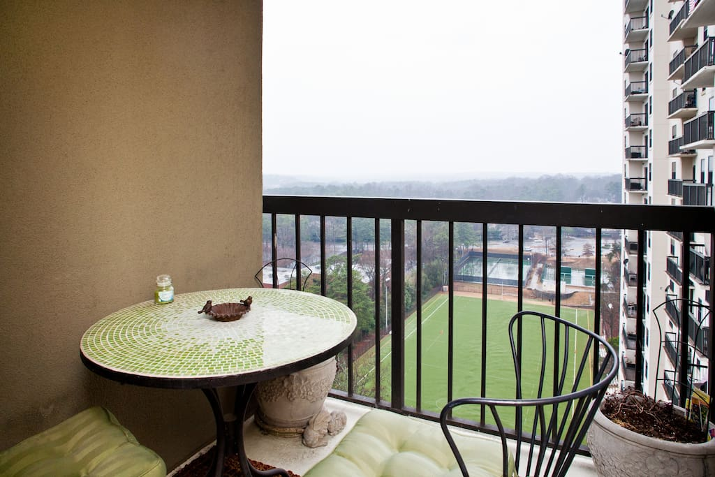 Balcony and views of soccer field and city in the distance, perfect for that cup of morning coffee or that evening  glass of wine.