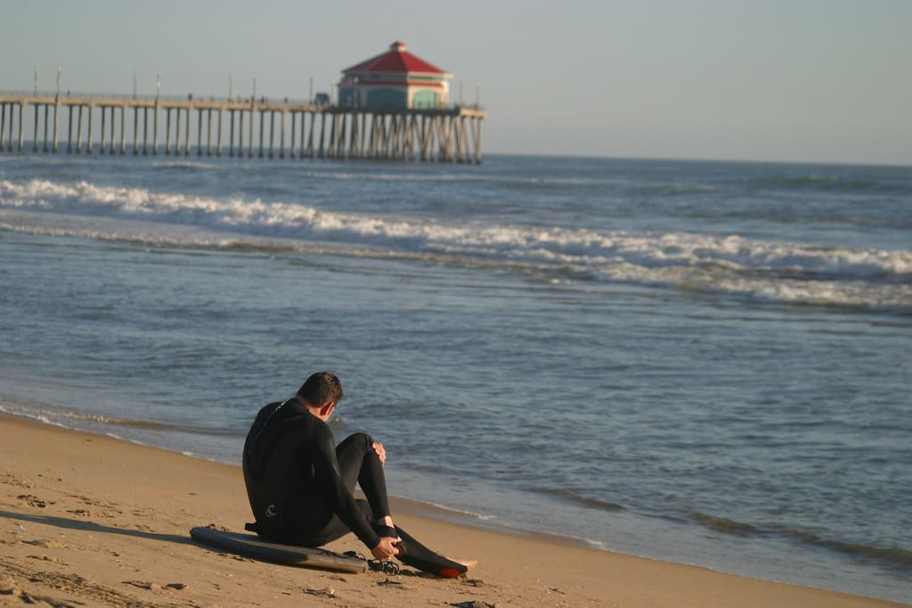 A surfer gets ready to jump in and enjoy the waves!